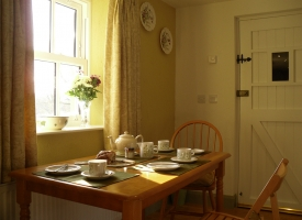 Dining table set for tea